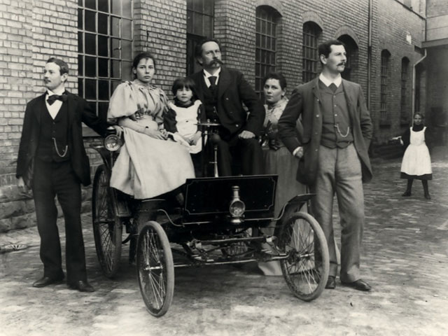 Carl Benz with his wife in first automobile