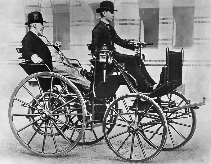 Gottlieb and Son in first motorized carriage - 1886